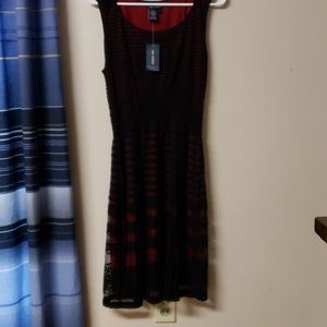 New with tags bkack lace with red lining sleeveles